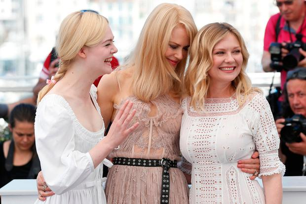 Actresses Elle Fanning, from left, Nicole Kidman and Kirsten Dunst pose for photographers during the photo call for the film The Beguiled at the 70th international film festival, Cannes, southern France, Wednesday, May 24, 2017. (AP Photo/Thibault Camus)
