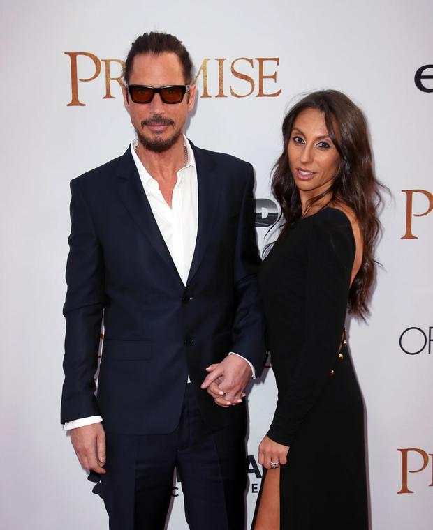 HOLLYWOOD, CA - APRIL 12: Musician Chris Cornell (L) and wife Vicky Karayiannis attend the premiere of Open Road Films'