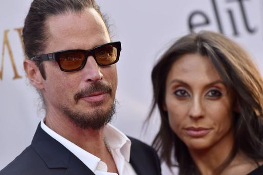 HOLLYWOOD, CA - APRIL 12: Musician Chris Cornell and wife Vicky Karayiannis arrive at the Premiere of Open Road Films' 'The Promise' at TCL Chinese Theatre on April 12, 2017 in Hollywood, California. (Photo by Axelle/Bauer-Griffin/FilmMagic)