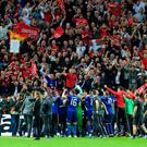 Manchester United players celebrate winning the Europa League