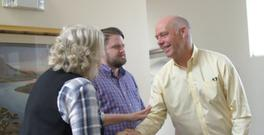 Montana Republican congressional candidate Greg Gianforte greets voters while campaigning for a special election in Missoula, Montana, U.S. May 24, 2017 in this still image from video. REUTERS/Justin Mitchell