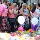 People observe a minute's silence in St Ann's Square, Manchester, to remember the victims of the terror attack in the city earlier this week. (PA)