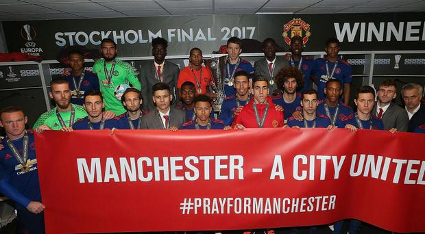 United's show of solidarity after their Europa League win on Wednesday. Getty
