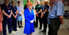 Britain's Queen Elizabeth speaks to staff during a visit to the Royal Manchester Children's Hospital in Manchester, Britain May 25, 2017. REUTERS/Peter Byrne/Pool