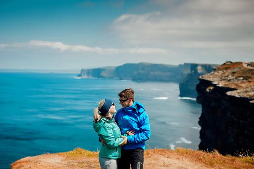 German Couple Martin and Stephanie enjoy the sunshine along the Cliff Walk, at the Cliffs of Moher in Co Clare. Photo: Brian Arthur