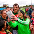 Mayo's Chris Barrett poses for 'selfies' with fans after Mayo's victory against Sligo. Photo: Stephen McCarthy/Sportsfile