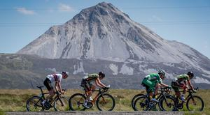 Riders pass Mount Errigal during Stage 5 of the Rás from Buncrana to Dungloe in Co Donegal. Photo: INPHO