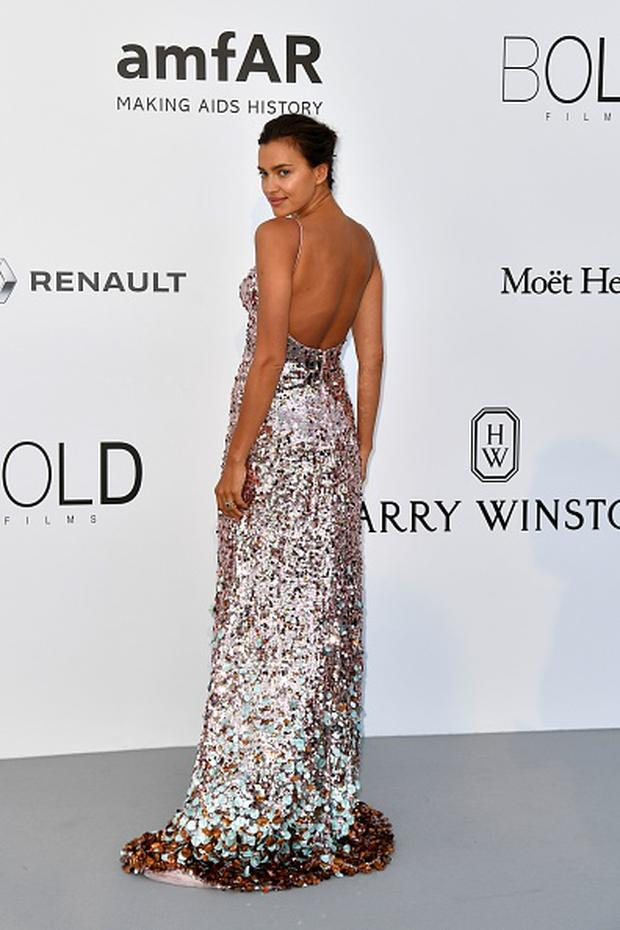 Russian model Irina Shayk poses as she arrives for the amfAR's 24th Cinema Against AIDS Gala on May 25, 2017 at the Hotel du Cap-Eden-Roc in Cap d'Antibes, France. / AFP PHOTO / ALBERTO PIZZOLI (Photo credit: ALBERTO PIZZOLI/AFP/Getty Images)