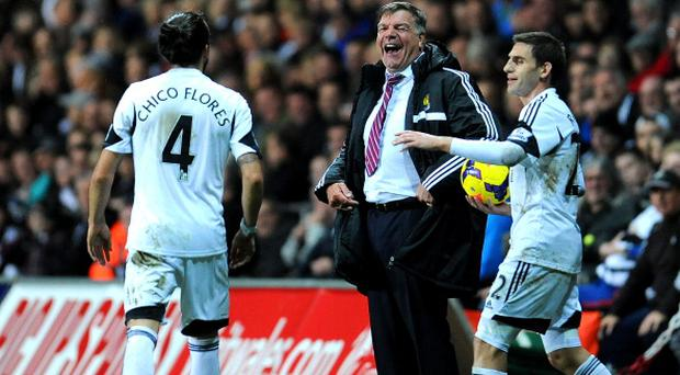 SWANSEA, WALES - OCTOBER 27: Manager of West Ham United Sam Allardyce laughs during the Barclays Premier League match between Swansea City and West Ham United at Liberty Stadium on October 27, 2013 in Swansea, Wales. (Photo by Tom Dulat/Getty Images)