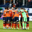 LUTON, ENGLAND - MAY 18: TV Cameramen get close to the Luton Town players as they form a huddle prior to the Sky Bet League Two Play off Semi Final Second Leg match between Luton Town and Blackpool at Kenilworth Road on May 18, 2017 in Luton, England. (Photo by Pete Norton/Getty Images)