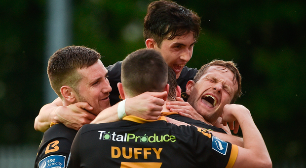 26 May 2017; David McMillan, hidden, of Dundalk celebrates after scoring his side's second goal with teammates, from left, Patrick McEleney, Jamie McGrath, Micheal Duffy, and Dane Massey during the SSE Airtricity League Premier Division match between St Patrick's Athletic and Dundalk at Richmond Park, in Dublin. Photo by David Maher/Sportsfile