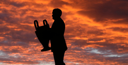 A statue of Jock Stein outside Celtic Park as the sun sets and, below, the manager of the Lisbon Lions in 1967. Photo: Reuters