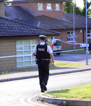 Police at the scene in Upper Ramone Park in Portadown Picture: Pacemaker/Arthur Allison