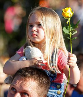 Ruby Tindall (3) at a vigil in Royton, near Manchester, yesterday. Photo: Reuters