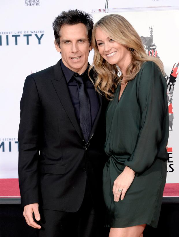 Actor Ben Stiller (L) and his wife actress Christine Taylor pose as he is honored with a hand and footprint ceremony at the TCL Chinese Theatre on December 3, 2013 in Los Angeles, California. (Photo by Kevin Winter/Getty Images)
