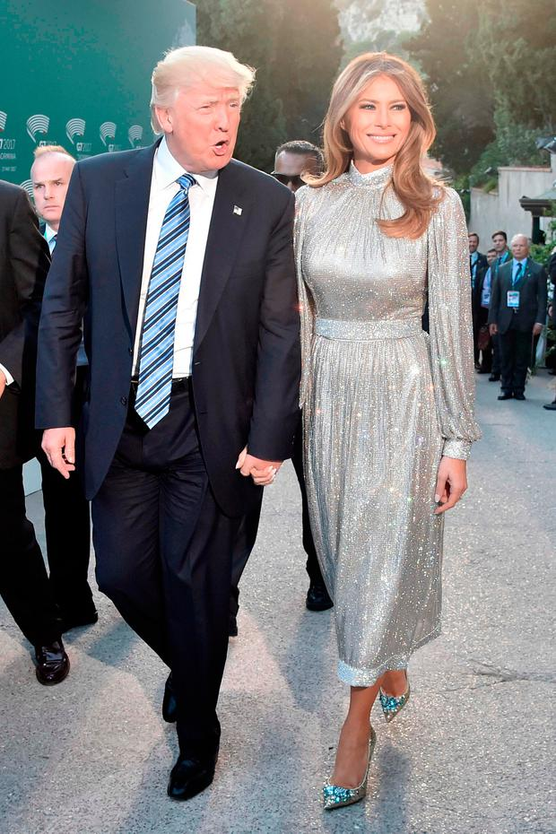 US President Donald Trump and US First Lady Melania Trump arrive for a concert of La Scala Philharmonic Orchestra at the ancient Greek Theatre of Taormina during the Heads of State and of Government G7 summit, on May 26, 2017 in Sicily. / AFP PHOTO / TIZIANA FABITIZIANA FABI/AFP/Getty Images