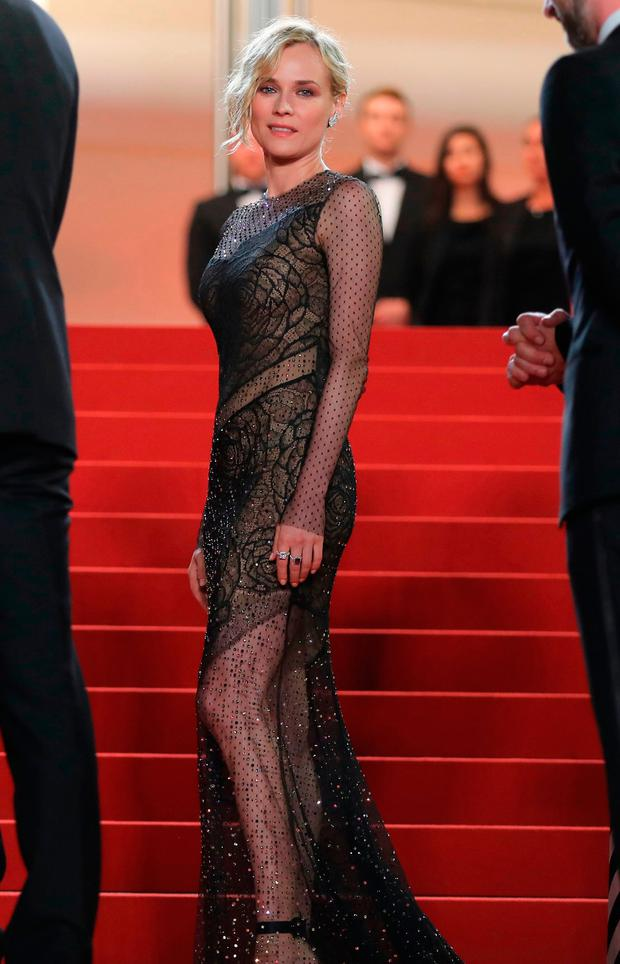 German actress Diane Kruger poses as she arrives on May 26, 2017 for the screening of the film 'In the Fade' (Aus dem Nichts) at the 70th edition of the Cannes Film Festival in Cannes, southern France. / AFP PHOTO / Valery HACHEVALERY HACHE/AFP/Getty Images