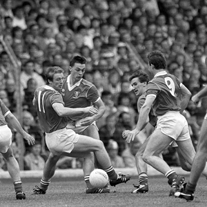 Cork's Dave Barry (14), Larry Tompkins (11) Tony Davis and Teddy McCarthy (9) in action against Meath's Mattie McCabe and P.J Gillic (8) in the 1988 All Ireland final