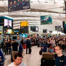 Handout photo taken with permission from the Twitter feed of @theboyg of queues at British Airways check in desks at Heathrow Airport: @theboyg/PA Wire