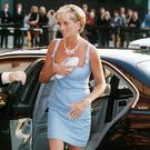 Princess Diana using her clutch to protect her modesty