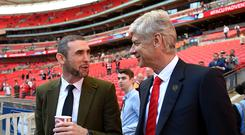 LONDON, ENGLAND - APRIL 18: Arsene Wenger, manager of Arsenal, (R) chats to former Arsenal player Martin Keown prior to the FA Cup Semi-Final match between Arsenal and Reading at Wembley Stadium on April 18, 2015 in London, England. (Photo by Michael Regan - The FA/The FA via Getty Images)