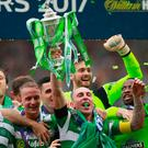 Celtic's Scott Brown lifts the trophy as he celebrates winning the Scottish Cup Final with team mates