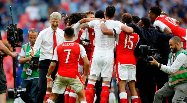 Arsenal manager Arsene Wenger and Alexis Sanchez celebrate after winning the FA Cup final
