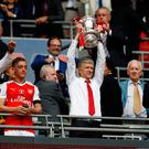 Arsenal manager Arsene Wenger celebrates with the trophy after winning the FA Cup final