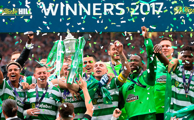 Scott Brown of Celtic lifts the SPL trophy last season. Photo: Getty Images