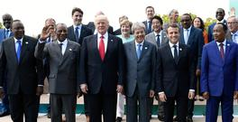 Kenya's President Uhuru Kenyatta, Guinea's President Alpha Conde, U.S. President Donald Trump, Italian Prime Minister Paolo Gentiloni, French President Emmanuel Macron, Niger's President Mahamadou Issoufou pose for a family photo with other participants of the G7 summit