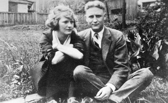 Family album snapshot of the American novelist F Scott Fitzgerald and his wife Zelda sitting on a lawn at her mother's home