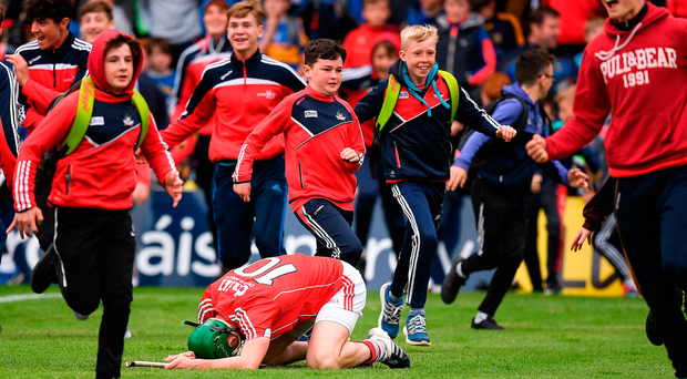 21 May 2017; Seamus Harnedy of Cork falls to his knees as Cork supporters rush to celebrate victory, over Tipperary, after the Munster GAA Hurling Senior Championship Semi-Final match between Tipperary and Cork at Semple Stadium in Thurles, Co Tipperary. Photo by Ray McManus/Sportsfile
