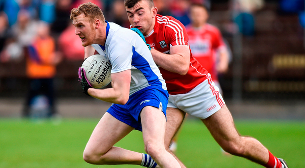 Ray O'Ceallaigh is tackled by Cork's Peter Kelleher during last night's Munster SFC clash in Dungarvan. Photo: Sportsfile