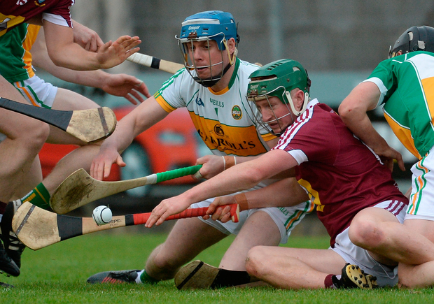 Niall O'Brien of Westmeath contests possession with Offaly goalkeeper James Dempsey. Photo: Sportsfile