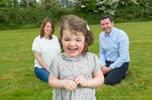 THE TREMENDOUS TWOS: Aoife Healy with her parents Colette and Jonathan. Photo: Michael McSweeney