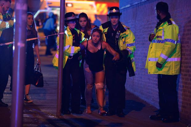 A young girl is attended to by the police services after suffering an injury in the blast.