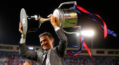 Barcelona's head coach Luis Enrique holds up the cup after winning the Copa del Rey final