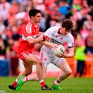 Rory Brennan of Tyrone is tackled by Niall Keenan of Derry during the Ulster GAA Football Senior Championship Quarter-Final match between Derry and Tyrone at Celtic Park in Derry. Photo by Ramsey Cardy/Sportsfile