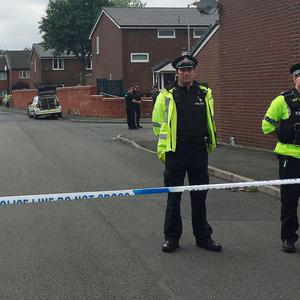 Police activity at a cordon in Quantock Street, Moss Side, as fresh arrests and raids are carried out in Manchester linked to Monday's suicide bombing. PRESS ASSOCIATION Photo. Picture date: Sunday May 28, 2017.