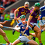 Sean Downey of Laois in action against Diarmuid O'Keeffe, left, and Matthew O'Hanlon of Wexford