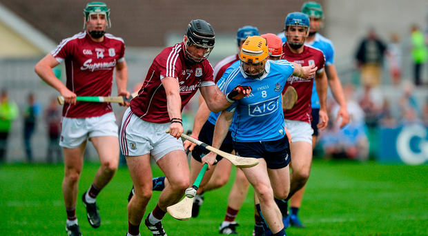 Ben Quinn of Dublin in action against Aidan Harte of Galway