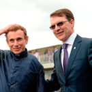 Jockey Ryan Moore with trainer Aidan O'Brien after winning Tattersalls Irish 1,000 Guineas on Winter