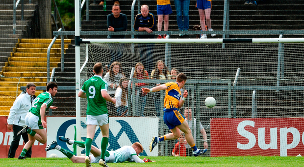Eoin Cleary of Clare shoots to score his side's first goal past Limerick goalkeeper Donal O'Sullivan