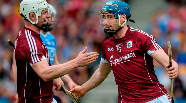 Conor Cooney, right, and Joe Canning of Galway celebrate after Cooney scored his side's second goal
