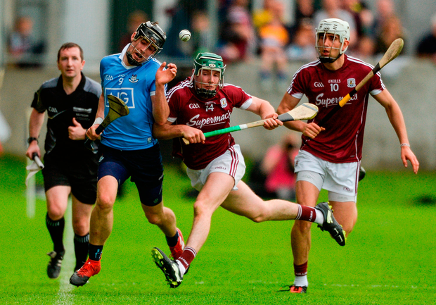 Sean Moran of Dublin is shouldered out over the sideline by Cathal Mannion of Galway