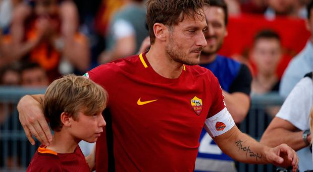 Roma's Francesco Totti with his son Cristian after his last game