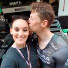 Sam Bennett kisses girlfriend Tara after the final time trial in Milan