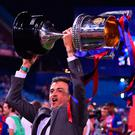 Barcelona manager Luis Enrique lifts the Copa Del Rey trophy after the team's 3-1 victory over Alaves in his final game as manager. Photo: Josep Lago/AFP/Getty Images