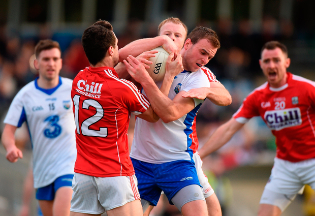 Waterford's James McGrath in action against John O'Rourke and Michael Shields of Cork. Photo: Matt Browne/Sportsfile