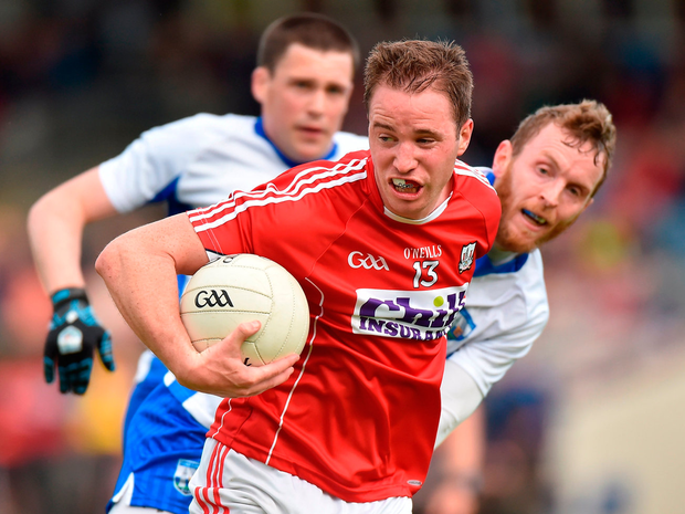 Cork's Colm O'Neill Fends off Waterford's Thomas O'Gorman. Photo: Matt Browne/Sportsfile